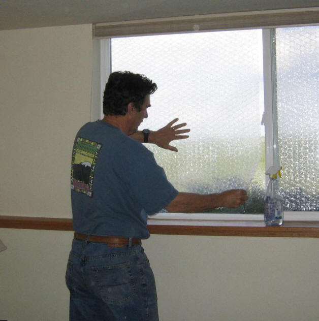 How do you cover windows in plastic?