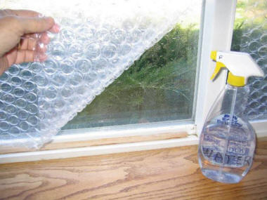 Cut The Bubble Wrap To Size Of Window Pane With Scissors