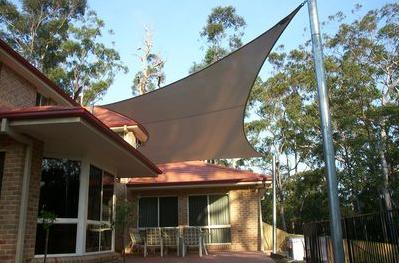 The 4 Sided Polygon Style Of Shade Sail. The Support Heights Are Arranged  With The Diagonals At Different Heights To Promote Stability In The Wind.